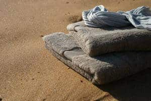 towels-on-beach-giving-up-the-five-tibetan-rites